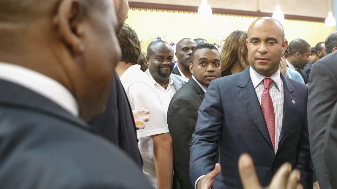 Haitian Prime Minister, Laurent Lamothe, greets a throng of guests and well-wishers as he enters the center.