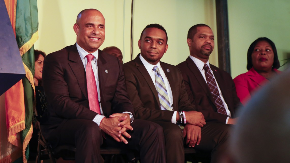 Haitian Prime Minister, Laurent Lamothe,left, smiles at the audience at the opening of the Caribbean Marketplace in Little Haiti.