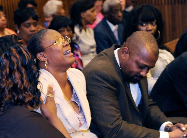 Monica McBride, mother of Renisha McBride, cries during the reading of verdict of guilty of of second-degree murder and manslaughter for Theodore Wafer, Thursday, Aug. 7, 2014 in Detroit. Walter Ray Simmons, Renisha's father, is at right. Wafer, 55, shot Renisha McBride through a screen door on Nov. 2, hours after she crashed into a parked car a half-mile from his house. The jury convicted Wafer of second-degree murder and manslaughter after deliberating for about eight hours over two days. (AP Photo/The Detroit News, Clarence Tabb Jr.)