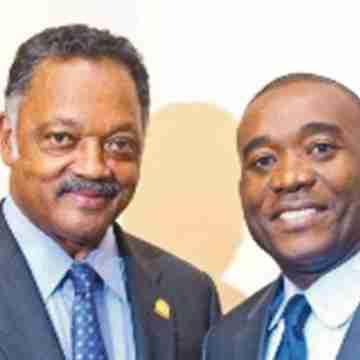 First Haitian Commissioner, first Haitian Chairman