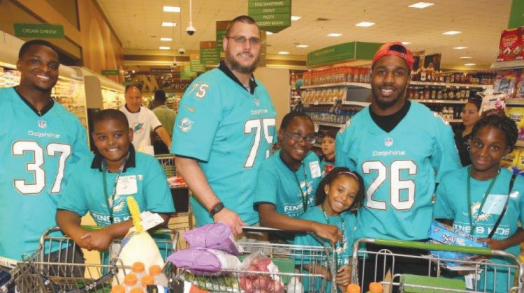 Miami Dolphins, children shop in Thanksgiving holiday spree