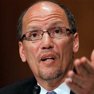 US labor secretary lauds federal health care law