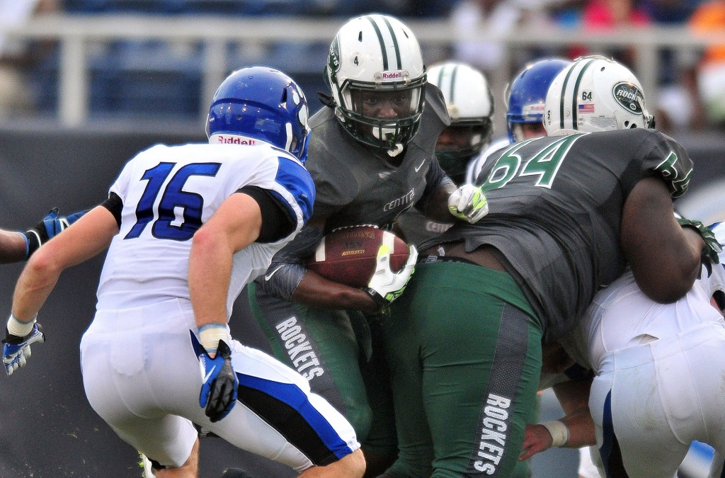 NOT SO FAST: Miami Central's Anthony Jones (No. 4) looks for running room as Washington state Bothell's Tongi Langi (No. 16) prepares to make the tackle in the second quarter of State Championship Bowl Series game 2 on Saturday at FAU stadium in Boca Raton