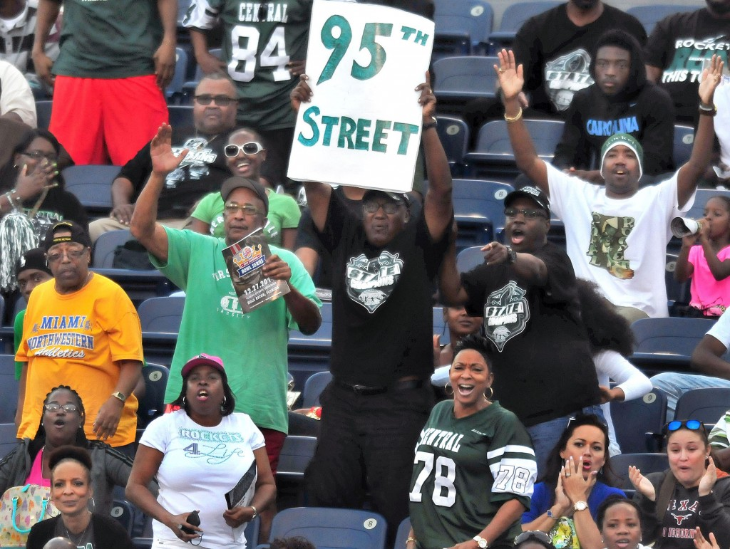 TOUCHDOWN: Miami Central High School fans react to a first-quarter score that put the nation's No. 6 team up 10-0 toward a 37-27 victory over Bothell (WA), in the second game of the inaugural State Championship Bowl Series, Saturday at FAU Stadium in Boca Raton. Fourth-ranked Miami-Booker T. Washington delivered No. 8 Bingham (of South Jordan, Utah) a 34-28 overtime, comeback defeat in the finale of the daylong, three-game event.