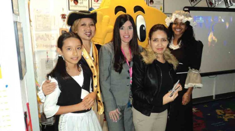 Fifth-grade students at Pembroke Lakes Elementary School recently took an electronic field trip back to colonial times to sing songs, dress in period costumes and watch Colonial Idol, a musical competition modeled after the current-day American Idol. Sponsored by BrightStar Credit Union for 60 Broward County elementary and middleschools, the e-field trips are broadcast online and allow students to interact with actors, ask questions and learn about life in colonial times. The Colonial Williamsburg Foundation in Williamsburg, VA, (www.history.org) which runs the world's largest living history museum dedicated to the study of 18th century American history and culture, provided the curriculum. Participating in Colonial Idol in the photo at right/left/above/below are (left to right) Keyla Jaramillo, a fifth grade student; Marjuree Larin, BrightStar Credit Union; Sandra Shipman, principal, Pembroke Lakes Elementary; Jenny Summerall, teacher, Pembroke Lakes Elementary; and Blaise DaCosta, BrightStar Credit Union