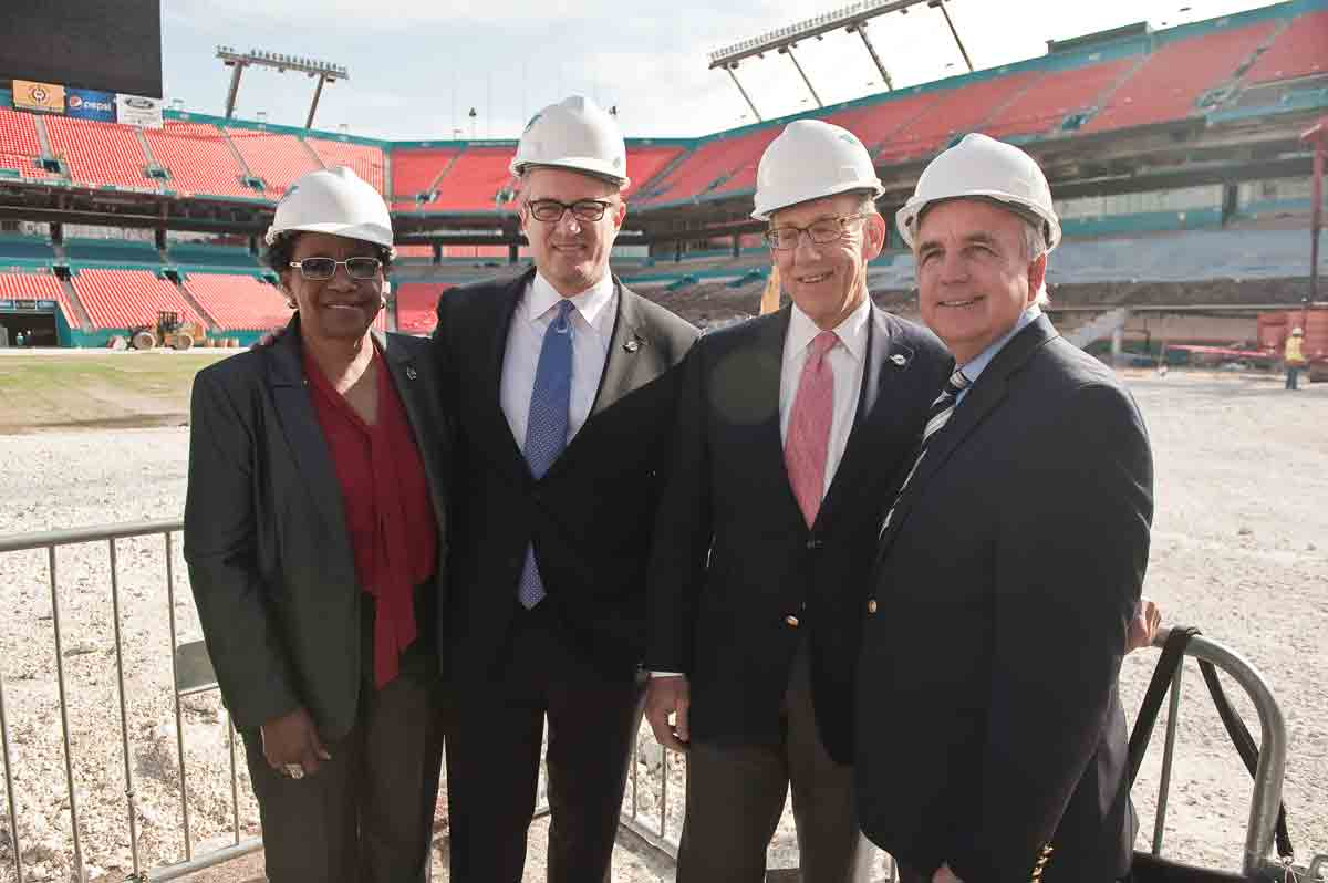 Leaders throughout Miami-Dade County recently assembled at Sun Life Stadium in Miami Gardens to witness the beginning of a major renovation of the Miami Dolphins' home. Sporting hard hats and protective gear, public officials, community leaders and Miami's business elite came out to celebrate the groundbreaking of this sports arena, which officials hope will attract future Super Bowl games and collegiate championships. Above: Construction workers begin moving seats and preparing to upgrade the Miami Dolphins' home turf. Right: Commissioner Barbara Jordan, Miami Dolphins President & CEO Tom Garfinkel, Dolphins Owner Stephen Ross, and Miami-Dade County Mayor Carlos Gimenez sport hard hats as they tour Sun Life Stadium and witness the upgrades currently underway.  According to the Miami Dolphins administration, conservative estimates indicate the stadium modernization project will bring at least 4,000 good paying jobs to Miami-Dade County.