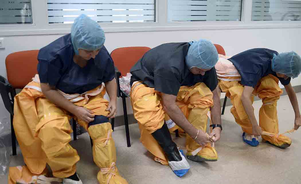 UK-military-health-care-provider-with-Ebola-coming-back