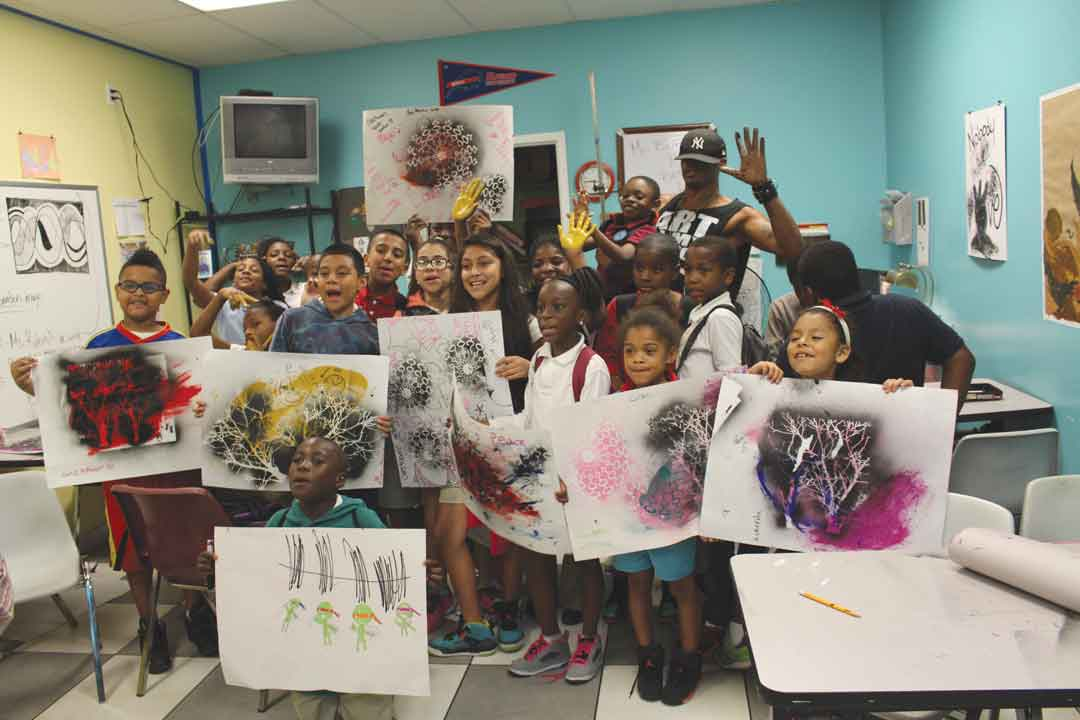 "In honor of National Youth Art Month, The Urban Collective and The Black Archives History and Research Foundation of South Florida led dozens of children from the Overtown Youth Center and Urgent Inc. on a tour and discussion of the exhibition to  celebrate late artist Purvis Young,  ""A Man Among the People."" The students got a chance to learn about art forms and create their own masterpieces."