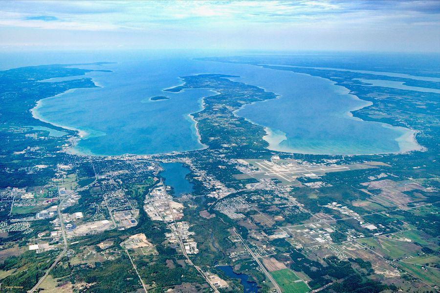 High aerial photo showing Traverse City and both arms of Grand Traverse Bay on 9/18/06