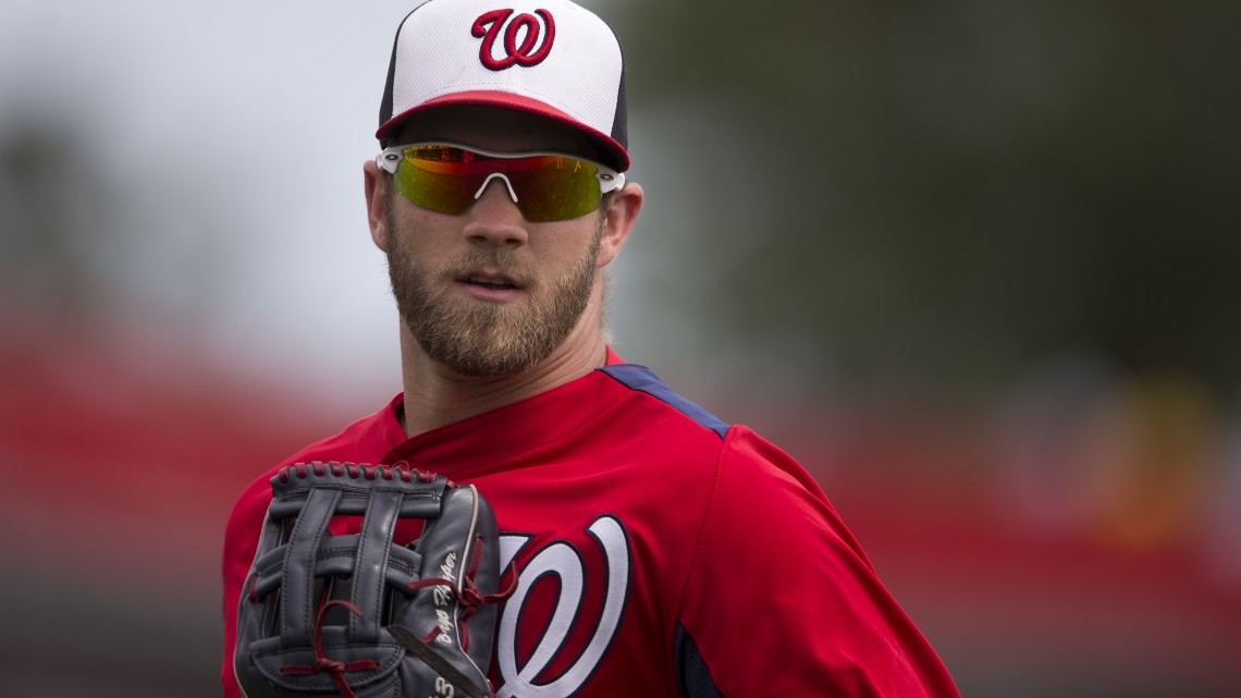 Washington Nationals outfielder Bryce Harper runs to the dugout during the sixth inning of an exhibition spring training baseball game against the Atlanta Braves on Sunday, March 24, 2013, in Viera, Fla.  (AP Photo/Evan Vucci)