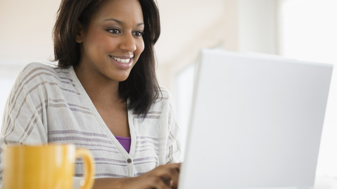 African American woman using laptop