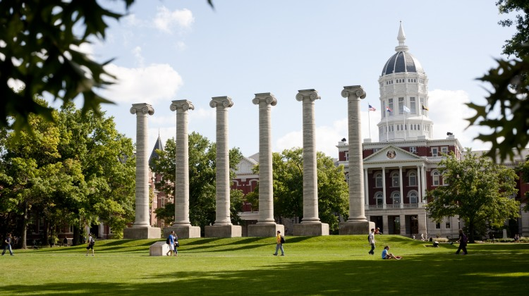 classic columns from side in summer framed by green; jesse dome view from cornell