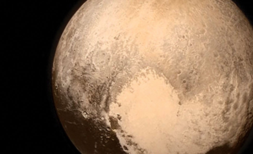 Spacecraft-makes-flyby-of-icy,-mystery-world