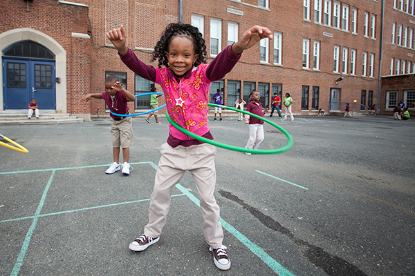 Kids playing hulahoop during recess in the Playworks program, Hamilton Elementary School, Baltimore, Maryland.
