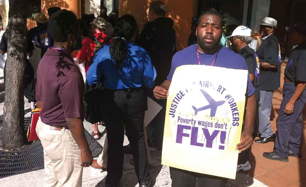 Airport-workers-demand-living--wage--during-commission-meeting