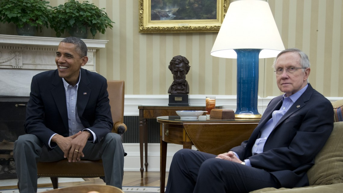 FILE - In this Oct. 12, 2013, file photo President Barack Obama, Senate Majority Leader Harry Reid of Nev., right, and other Democrat Senators meet in the Oval Office of the White House in Washington. Obama and congressional Democrats are relishing the party unity forged by the fall fiscal fights after some Democrats broke with the president this summer over Syria, government spying, and his leadership choice for the Federal Reserve. But their solidarity will face a tough test if Obama opens negotiations with Republicans on spending levels and entitlement cuts, areas where Democrats have long feared the president is willing to give away too much.(AP Photo/Carolyn Kaster)