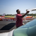 ADVANCE FOR SATURDAY, SEPT. 26, 2015, AT 12:01 A.M. EDT - Theron Burton, an IT business owner and pilot, checks the wings of his plane at the Greenville Downtown Airport in Greenville, S.C., Tuesday, Sept. 1, 2015. Burton and Greenville pilot Clint Thompson have launched an effort to create a network group of other minority pilots throughout the Southeast. (Mykal McEldowney/The Greenville News via AP) NO SALES; MANDATORY CREDIT