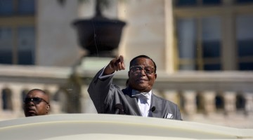 "Nation of Islam leader Louis Farrakhan speaks from behind a layer of glass on the steps of the U.S. Capitol at a rally billed as ""Justice or Else"" to mark the 20th anniversary of the Million Man March on the National Mall in Washington October 10, 2015. The original Million Man March took place on October 16, 1995. REUTERS/James Lawler Duggan - RTS3WCK"