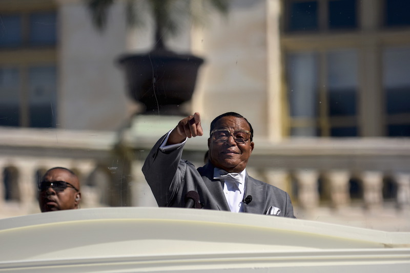 """Nation of Islam leader Louis Farrakhan speaks from behind a layer of glass on the steps of the U.S. Capitol at a rally billed as """"Justice or Else"""" to mark the 20th anniversary of the Million Man March on the National Mall in Washington October 10, 2015. The original Million Man March took place on October 16, 1995. REUTERS/James Lawler Duggan - RTS3WCK"""