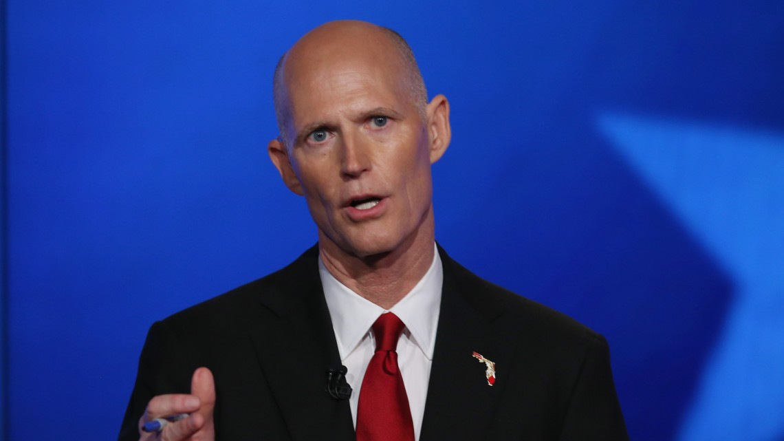 MIRAMAR, FL - OCTOBER 10:  Republican Florida Governor Rick Scott speaks during a televised debate with former Florida Governor and Democratic candidate Charlie Crist at NBCUniversal/Telemundo 51 on October 10, 2014 in Miramar, Florida.  Governor Scott is facing off against Crist in the November 4, 2014 governors race.  (Photo by Joe Raedle/Getty Images)