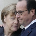 French President Francois Hollande embraces German Chancellor Angela Merkel, left, as she arrives at the Elysee Palace, Paris, Sunday, Jan. 11, 2015. A rally of defiance and sorrow, protected by an unparalleled level of security, on Sunday will honor the 17 victims of three days of bloodshed in Paris that left France on alert for more violence. (AP Photo/Thibault Camus)