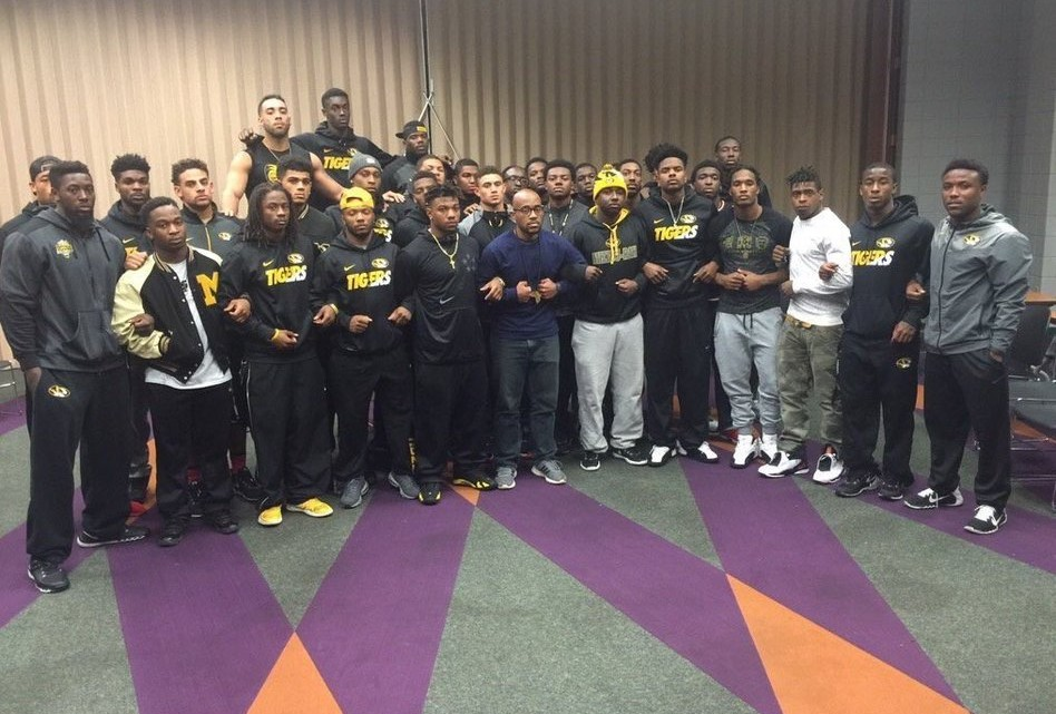 Members of the University of Missouri stand together, as they announce that they will not play until the university president steps down.