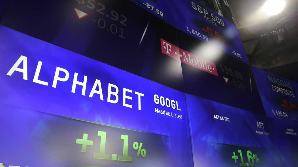 Electronic screens post the price of Alphabet stock, Monday, Feb. 1, 2016, at the Nasdaq MarketSite in New York. Alphabet, the parent company of Google, reports quarterly earnings Monday.  (AP Photo/Mark Lennihan) ORG XMIT: NYML110