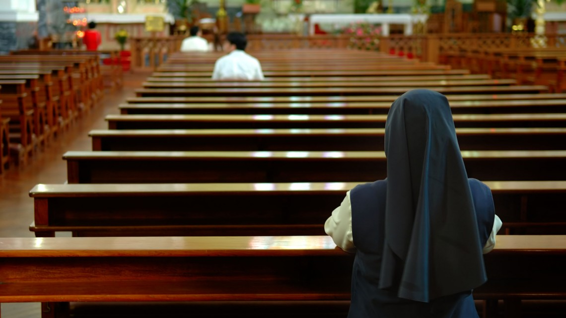 1564534 - a back view of praying sister inside church