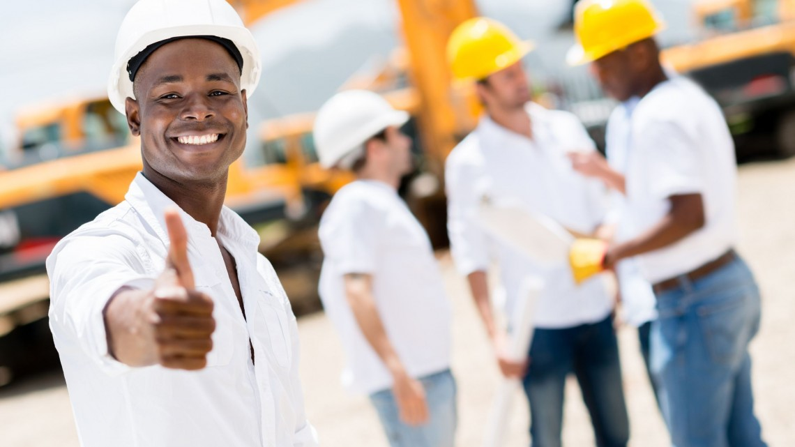 21467350 - happy engineer with thumbs up at a construction site