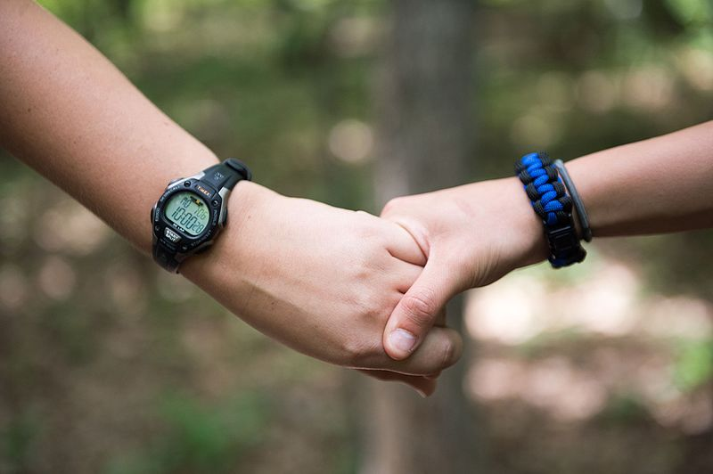2015_law_enforcement_explorers_conference_holding_hands_during_balance_drill