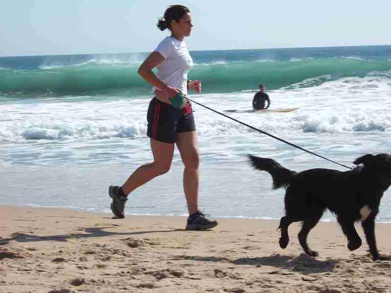 jogging_with_dog_at_carcavelos_beach