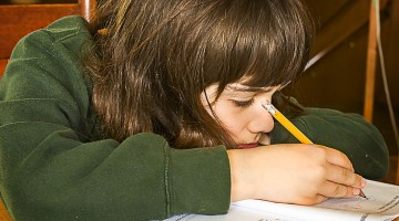 Boy_doing_homework_(4596604619)