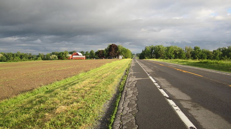 view_down_country_road_in_may