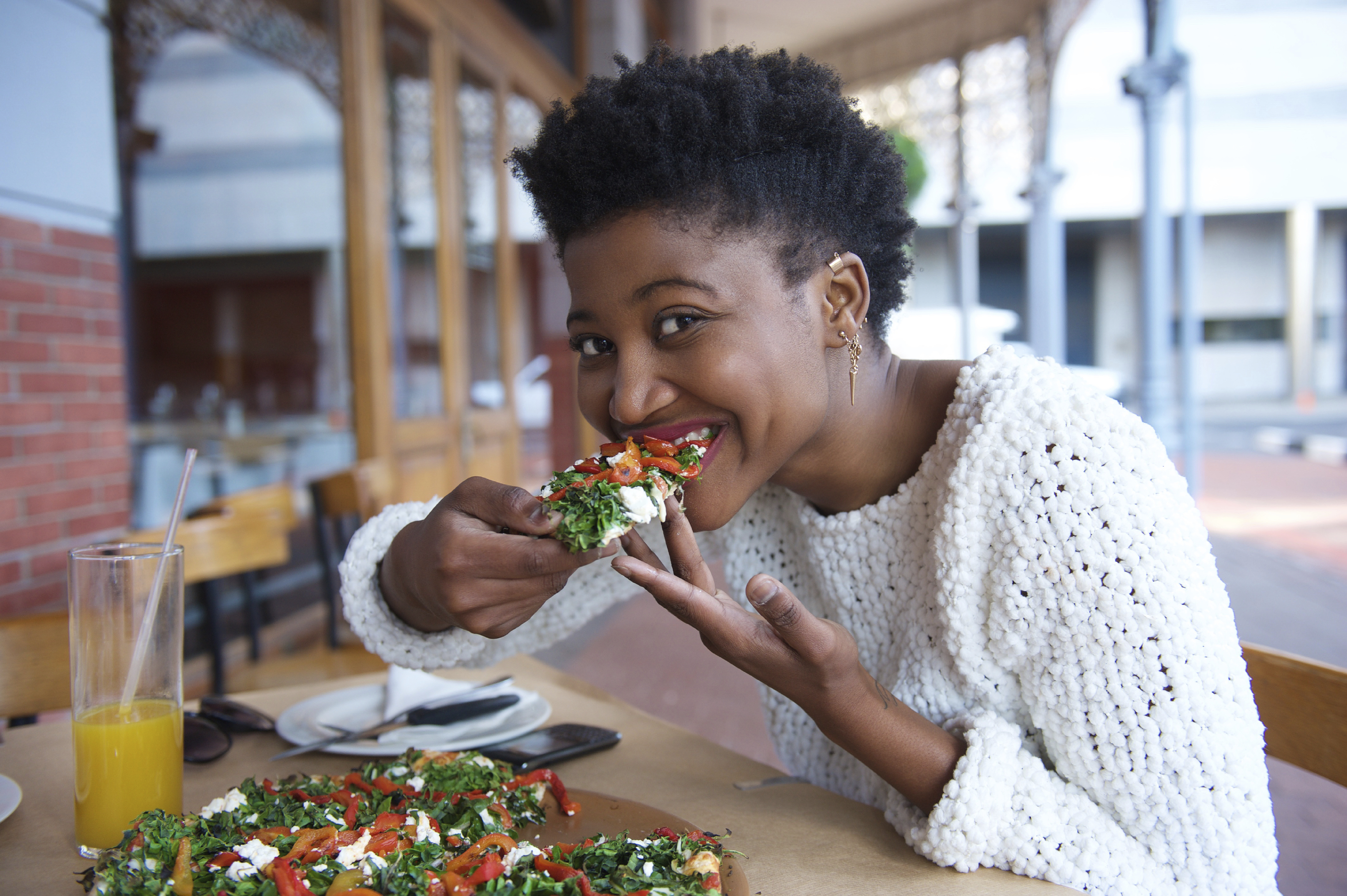 Close Up Portrait Of A Young Black Woman Eating Vegetarian Pizza How To Eat  Healthy When