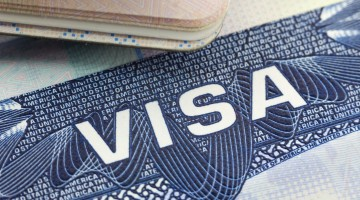 40041517 - the american visa in a passport page (usa) background