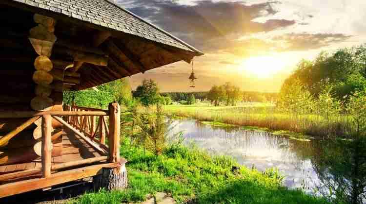 43642240 - wooden bathhouse near lake at the sunset