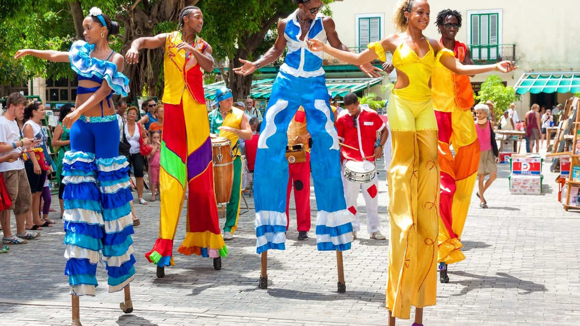 14667755 - street dancers on stilts in old havana