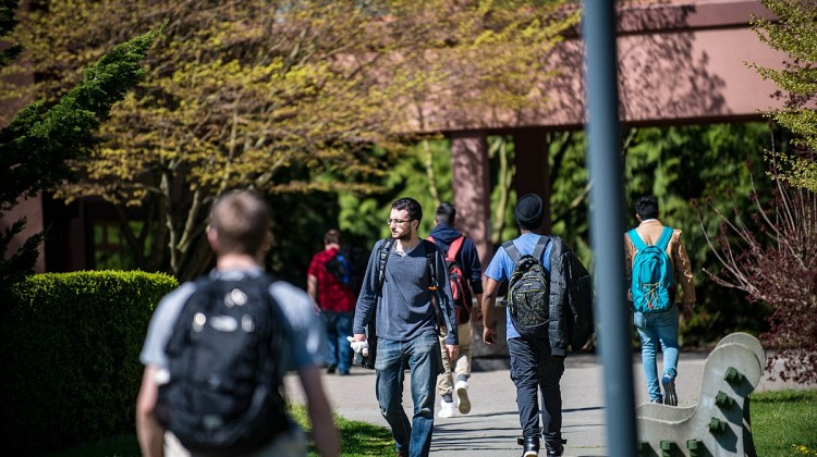 Student_on_the_green_-_male_students_walking-1_(26389780436)