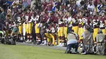 1200px-Washington_Redskins_National_Anthem_Kneeling_(37301887651)