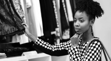36721585 - beautiful young african girl shopping in clothe's department