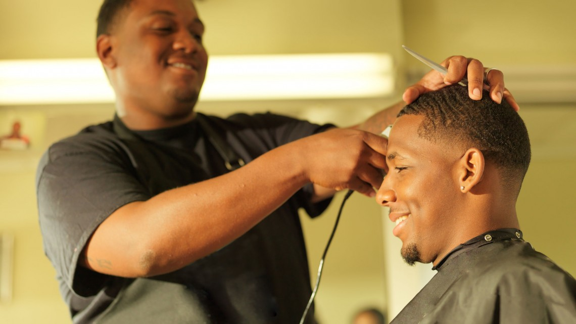 35717672 - man getting his hair cut at barber shop