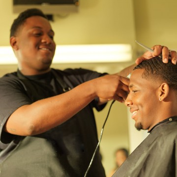 35717672 - man getting his hair cut at barber shop