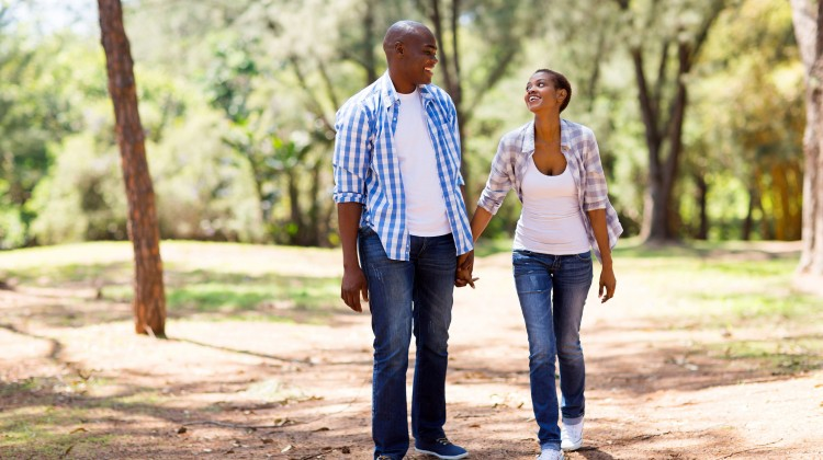 35919003 - happy african couple enjoying a walk at the park