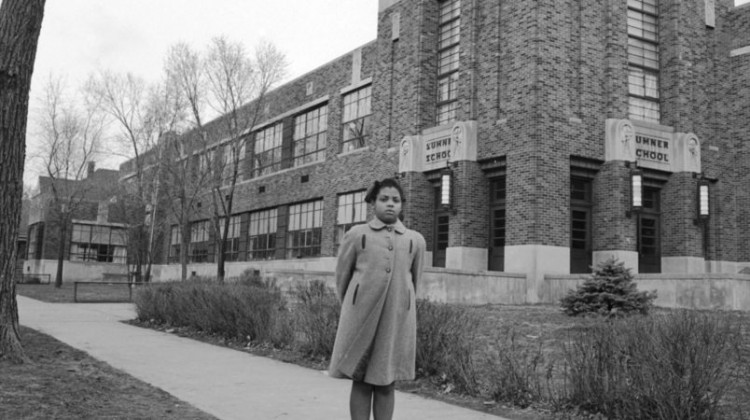 Portrait of nine-year-old African-American student Linda Brown as she poses outside Sumner Elementary School, Topkea, Kansas, 1953. When her enrollment in the racially segregated school was blocked, her family initiated the landmark Civil Rights lawsuit 'Brown V. Board of Education,' that led to the beginning of integration in the US education system. (Photo by Carl Iwasaki/The LIFE Images Collection/Getty Images)