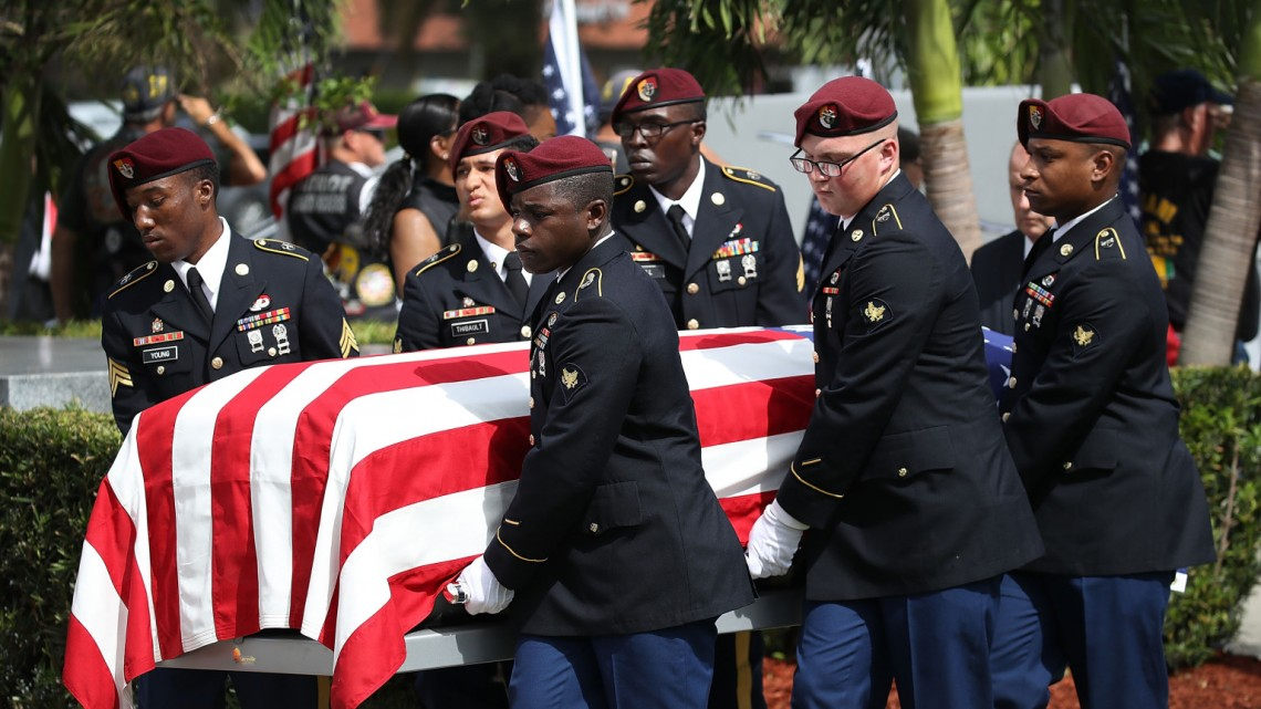 HOLLYWOOD, FL - OCTOBER 21:  U.S. Military honor guards carry the casket of U.S. Army Sgt. La David Johnson during his burial service at the Memorial Gardens East cemetery on October 21, 2017 in Hollywood, Florida. Sgt. Johnson and three other American soldiers were killed in an ambush in Niger on Oct. 4.  (Photo by Joe Raedle/Getty Images)