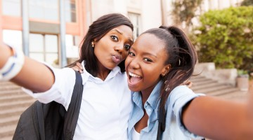 african college friends taking selfie together
